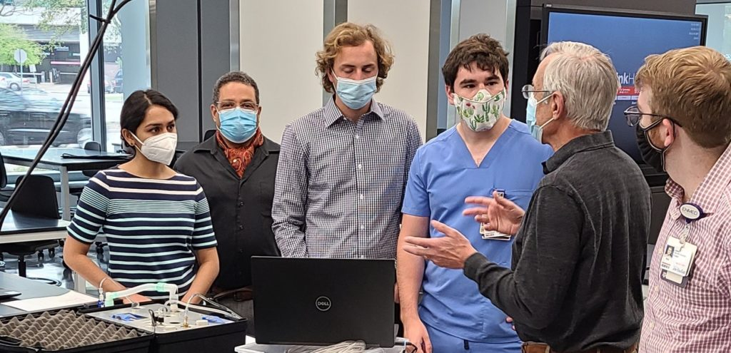 EnMed students and professors with ventilator